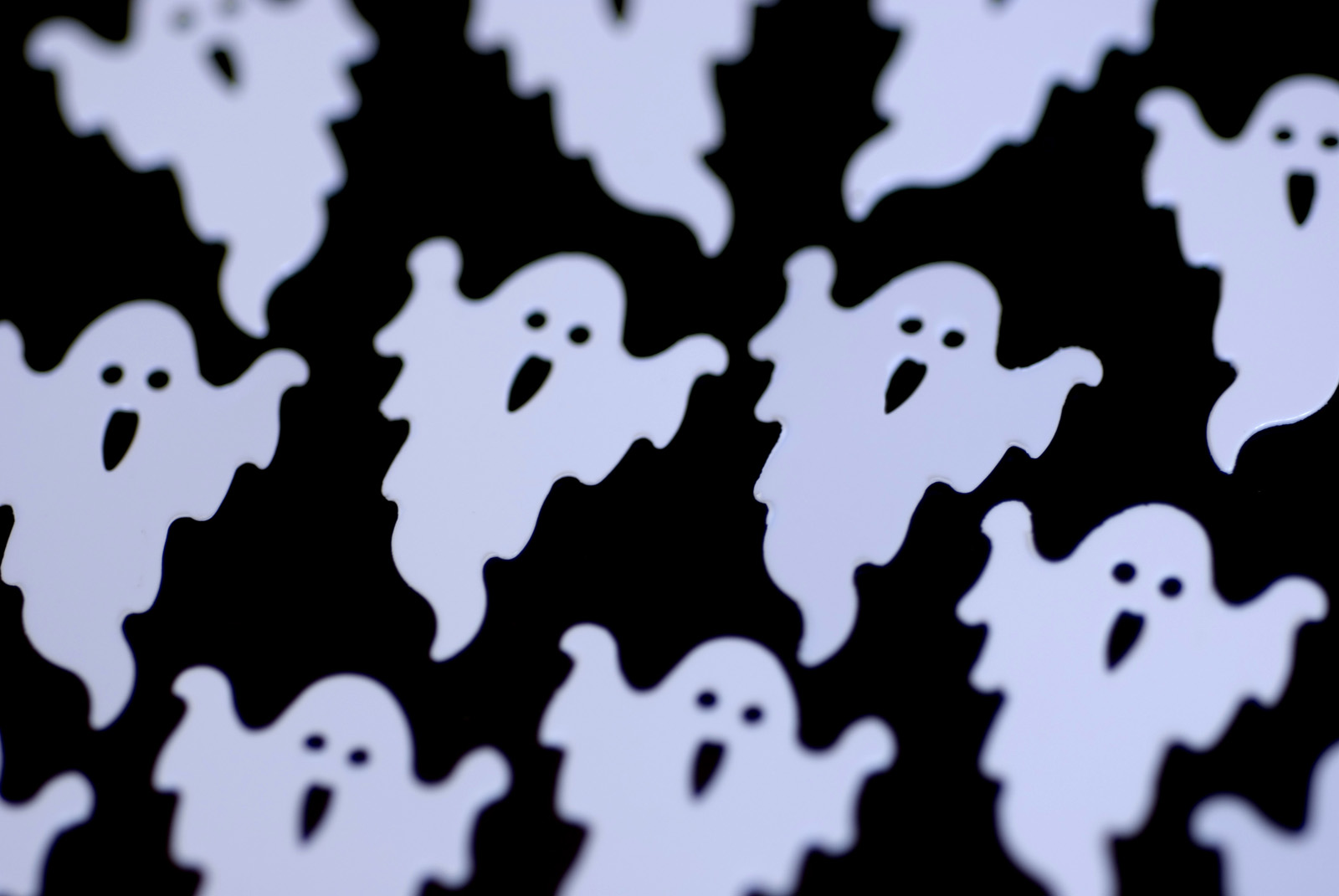 white ghost outline shapes